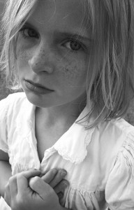 Girl with freckles and sad eyes