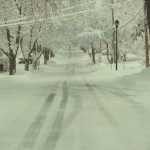 View of a snowy side street in Fairport NY