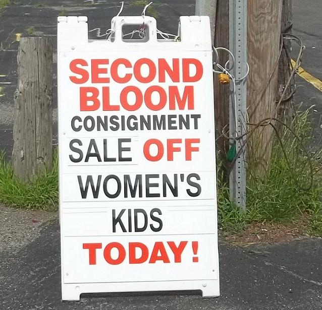 Sign says Women's Kids on Sale!